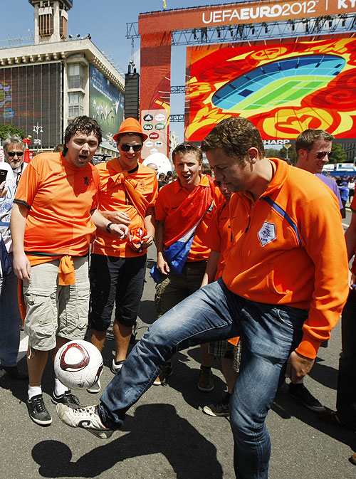 Netherlands' fans play with the ball during the Kyiv Fan Zone opening ceremony