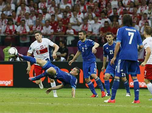 Greece's Papadopoulos kicks ball during the Group A Euro 2012 soccer match against Poland