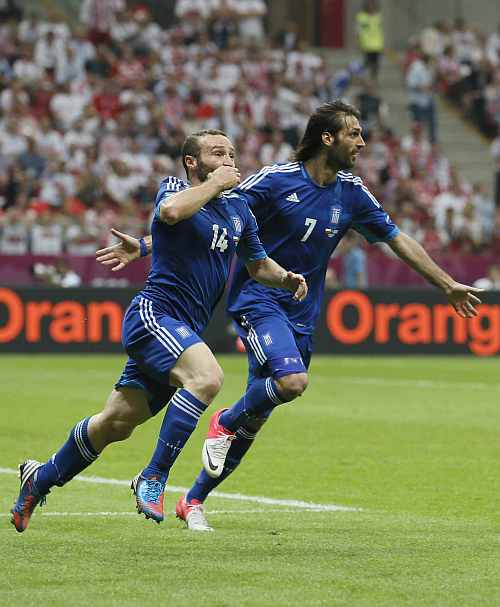Greece's Dimitris Salpingidis celebrates with his team mate Giorgos Samaras after scoring againist Poland