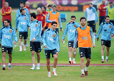 The Spanish national team make their way out of the field after a training session