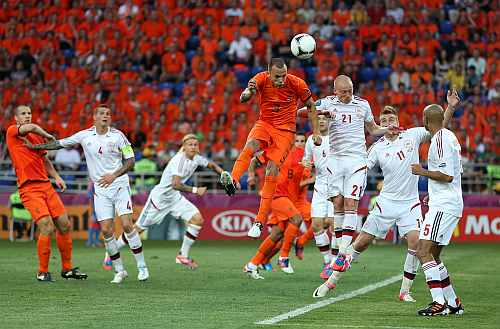 Wesley Sneijder of Netherlands heads the ball during the UEFA EURO 2012 group B match between Netherlands and Denmark