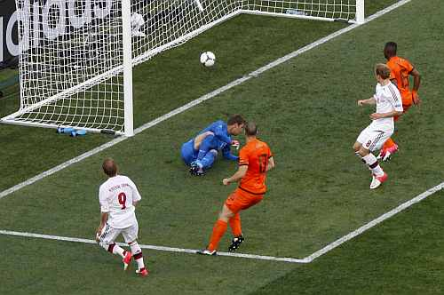 Denmark's Krohn-Dehli scores a goal against Netherlands' goalkeeper Stekelenburg during their Group B Euro 2012 soccer match