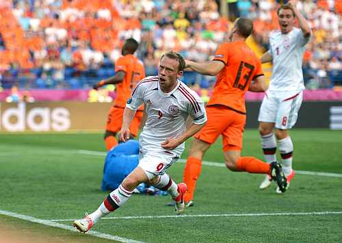 Michael Krohn-Dehli of Denmark turns to celebrate scoring their first goal during the UEFA EURO 2012 group B match between Netherlands and Denmark