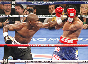 Timothy Bradley Jr. (left) connects on WBO welterweight champion Manny Pacquiao