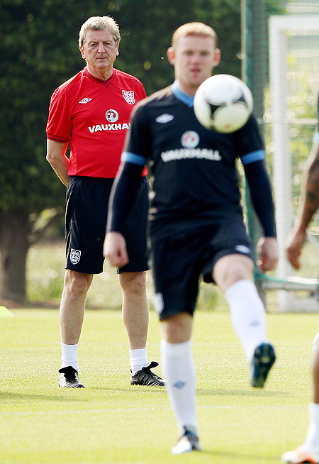 England manager Roy Hodgson looks on at Wayne Rooney