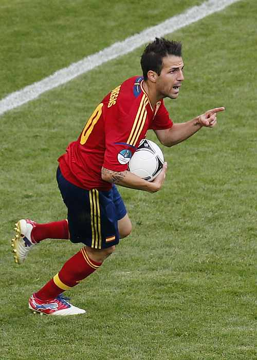 Spain's Cesc Fabregas celebrates after scoring against Italy during their Group C Euro 2012 soccer match at the PGE Arena stadium
