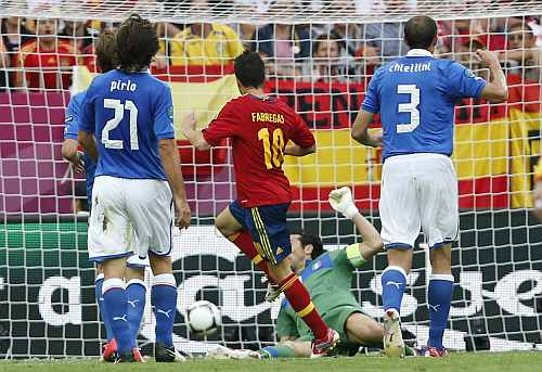 Spain's Cesc Fabregas (C) scores a goal against Italy during their Group C Euro 2012 soccer match at the PGE Arena stadium