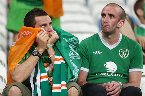 Ireland fans sit dejected in the stands after their team's defeat to Croatia