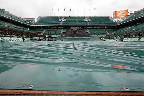 View of the Philippe Chartrier court as the men's singles final match was suspended for the day after rain stopped play during the French Open tennis tournament
