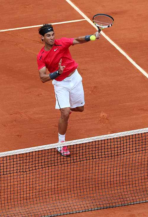 Rafael Nadal of Spain returns the ball to Novak Djokovic of Serbia during their men's singles final match at the French Open