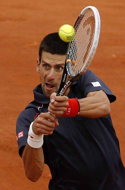 Novak Djokovic of Serbia returns the ball to Rafael Nadal of Spain during their men's singles final match at the French Open