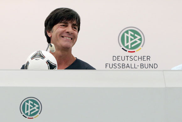 Germany's national soccer coach Joachim Loew smiles during a news conference ahead of their Euro 2012 soccer match against Netherlands