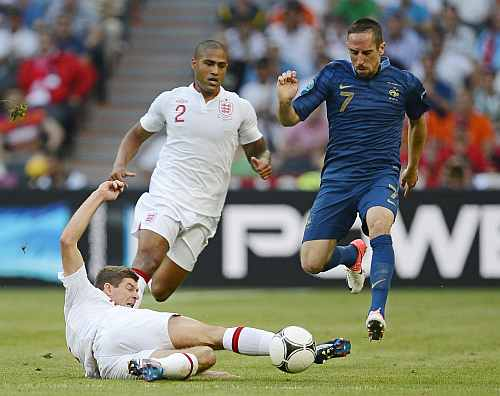 France's Franck Ribery (R) battles for the ball with England's Steven Gerrard (L) and Glen Johnson during the Group D Euro 2012 soccer match against France at Donbass Arena in Donetsk