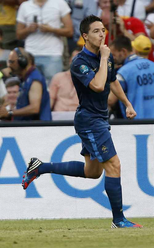 France's Samir Nasri gestures as he celebrates after scoring against England during their Group D Euro 2012 soccer match at the Donbass Arena in Donetsk