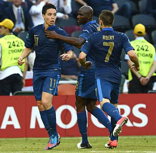 France's Samir Nasri (L), Alou Diarra (C) and Franck Ribery celebrate a goal against England during their Group D Euro 2012 soccer match