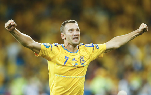 Ukraine's Andriy Shevchenko celebrates after winning their Group D Euro 2012 soccer match against Sweden at the Olympic stadium in Kiev