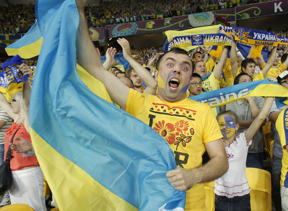 Ukraine's fans celebrate during their Group D Euro 2012 soccer match against Sweden at the Olympic stadium in Kiev