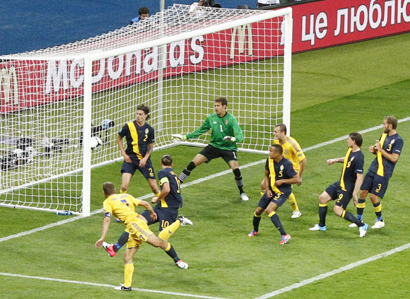 Ukraine's Andriy Shevchenko (L) scores his second goal against Sweden during their Group D Euro 2012 soccer match at the Olympic stadium in Kiev