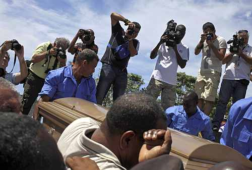 People carry the coffin of Cuban boxing great Teofilo Stevenson, during his funeral at Colon cemetery in Havana