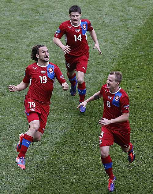 Czech Republic's Petr Jiracek (L) celebrates with his teammates David Limbersky (R) and Vaclav Pilar after scoring against Greece during their Group A Euro 2012 soccer match at the City stadium in Wroclaw