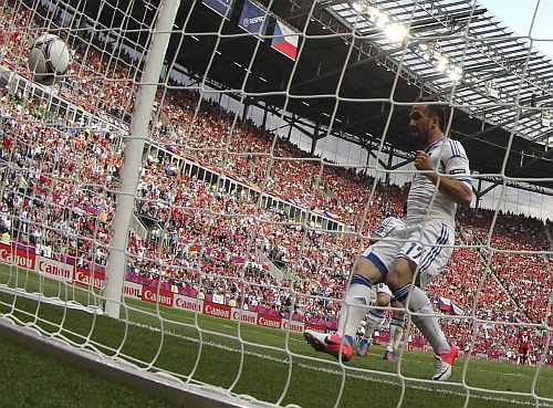 Greece's Fanis Gekas scores a goal during their Group A Euro 2012 soccer match against Czech Republic at the City stadium in Wroclaw