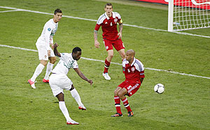 Portugal's Silvestre Varela (2nd from left) scores the winner against Denmark during their Group B match