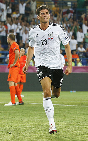 Germany's Mario Gomez celebrates after he scored a goal against Netherlands