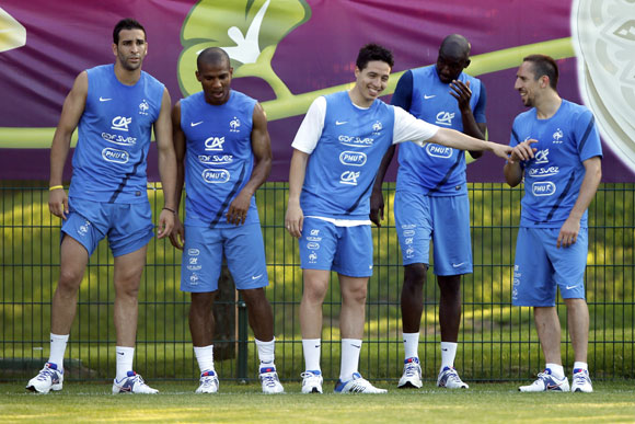 France's soccer players (From L) Adil Rami, Florent Malouda, Samir Nasri, Alou Diarra and Franck Ribery attend a training session at the team's training center in Kircha near Donetsk June 12, 2012. France drew 1-1 with England in their Group D Euro 2012 soccer match yesterday in Donetsk