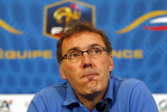 France's coach Laurent Blanc reacts during a news conference in Donetsk