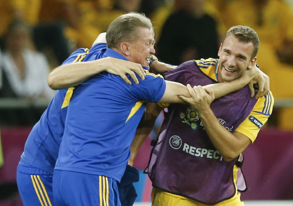 Ukraine's coach Oleg Blokhin celebrates with Ukraine's Andriy Shevchenko after winning their Group D Euro 2012 soccer match against Sweden at the Olympic stadium in Kiev