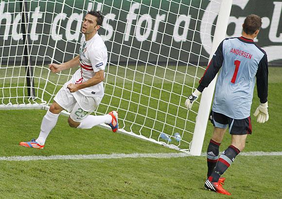 Portugal's Helder Postiga celebrates after scoring a against Denmark on Wednesday