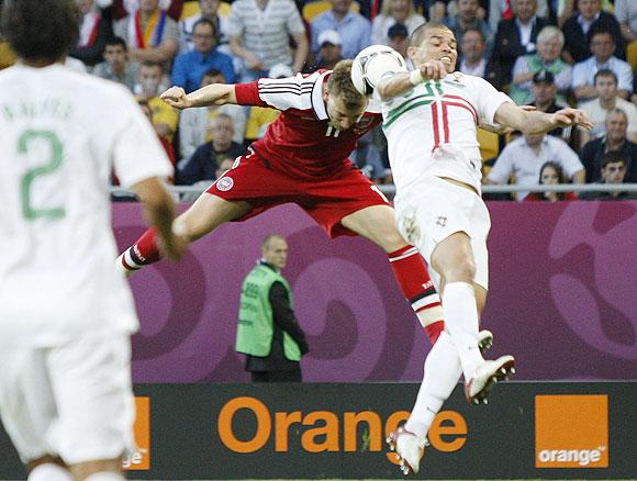 Denmark's Nicklas Bendtner (left) scores a goal past Portugal's Pepe