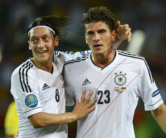 Germany's Mario Gomez (R) celebrates with Mesut Oezil scoring his second goal against Netherlands during their Euro 2012 Group B soccer match at the Metalist stadium in Kharkiv