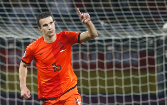 Netherlands' Robin van Persie celebrates after scoring a goal during their Group B Euro 2012 soccer match against Germany at the Metalist stadium in Kharkiv