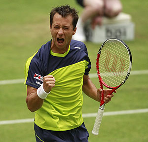 Philipp Kohlschreiber of Germany celebrates after defeating Rafael Nadal