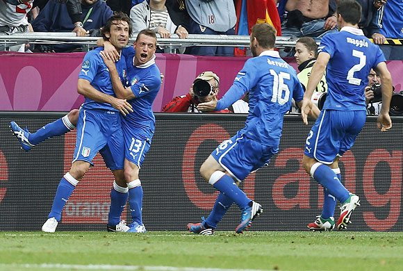 Italy's Andrea Pirlo (left) is congratulated by teammates after scoring against Croatia