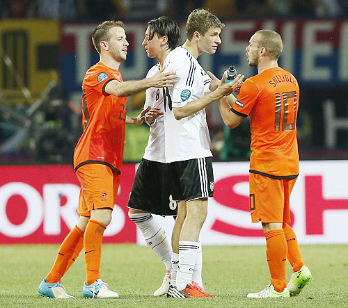 (From left) Netherlands' Rafael van der Vaart, Germany's Mesut Oezil, Thomas Mueller and Netherlands' Wesley Sneijder speak after their Euro match
