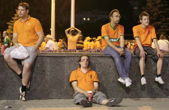 Netherlands' fans react at the end of their Group B Euro 2012 soccer match against Germany at the Metalist stadium in Kharkiv
