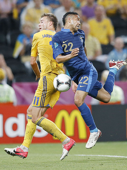 Ukraine's Andriy Yarmolenko (left) and France's Gael Clichy vie for possession