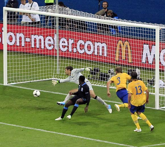 Danny Welbeck scores the third goal for England past Sweden's goalkeeper Andreas Isaksson