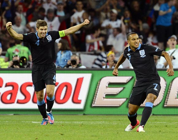 Theo Walcott (right) celebrates with Steven Gerrard