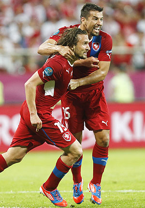 Scorer Czech Republic's Petr Jiracek (left) celebrates with teammate Milan Baros after scoring against Poland on Saturday