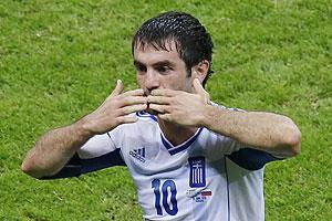 Greece's Giorgos Karagounis celebrates his goal against Russia on Saturday