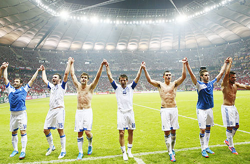 Greece's players celebrate victory against Russia