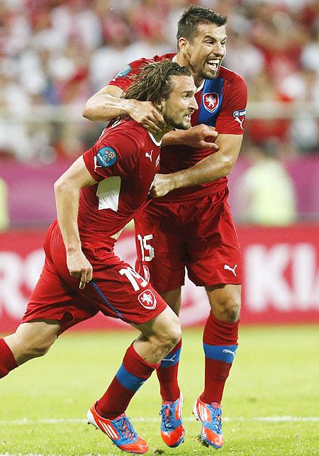 Scorer Czech Republic's Petr Jiracek (left) celebrates