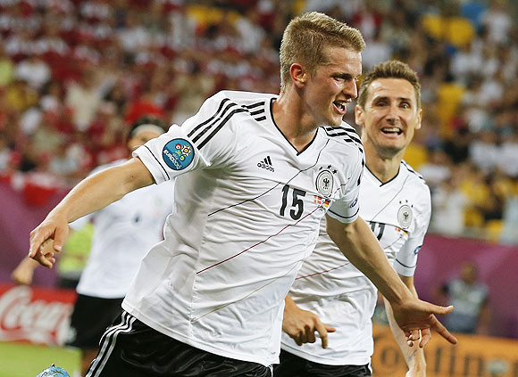 Germany's Lars Bender (left) celebrates with Miroslav Klose after scoring against Denmark