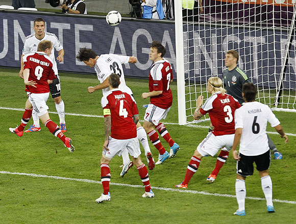 Denmark's Michael Krohn-Dehli (2nd from left) heads to score against Germany