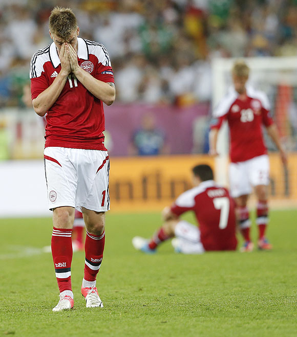 Denmark's Nicklas Bendtner (left) and teammates wear a sullen look after their loss to Germany