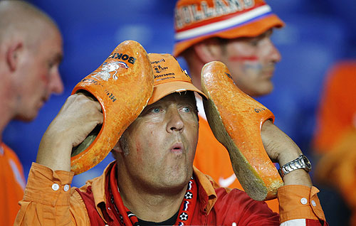 A Netherlands fan reacts after the Dutch lost to Portugal