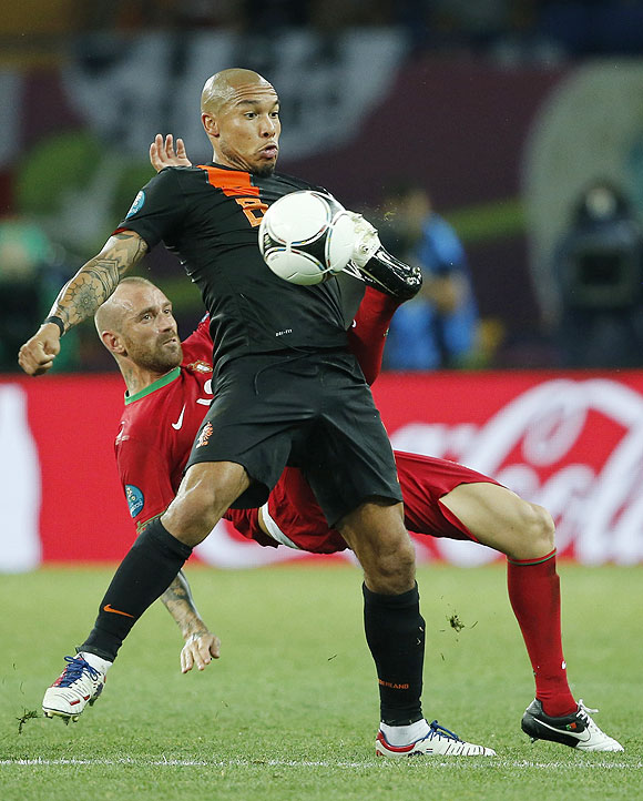 Portugal's Raul Meireles (left) and Netherlands' Nigel de Jong vie for possession